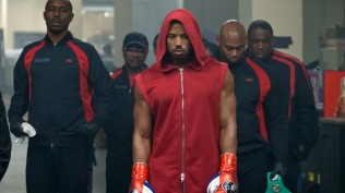 C2_09807_RC (left) Wood Harris stars as Tony 'Little Duke' Burton and (ctr) Michael B. Jordan as Adonis Creed in CREED II, a Metro Goldwyn Mayer Pictures and Warner Bros. Pictures film. Credit: Barry Wetcher / Metro Goldwyn Mayer Pictures / Warner Bros. Pictures © 2018 Metro-Goldwyn-Mayer Pictures Inc. and Warner Bros. Entertainment Inc. All Rights Reserved.