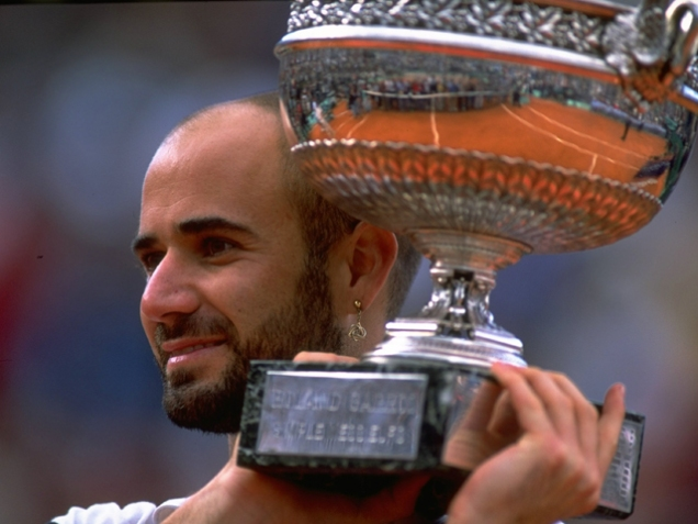 6 Jun 1999: Andre Agassi of the United States celebrates victory with the trophy during the 1999 French Open Final match against Andrei Medvedev of the Ukraine played at Roland Garros in Paris, France. The match finished in an emotional victory for Andre Agassi. Mandatory Credit: Al Bello /Allsport