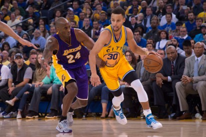 November 24, 2015; Oakland, CA, USA; Golden State Warriors guard Stephen Curry (30) dribbles the basketball against Los Angeles Lakers forward Kobe Bryant (24) during the third quarter at Oracle Arena. The Warriors defeated the Lakers 111-77. Mandatory Credit: Kyle Terada-USA TODAY Sports ORG XMIT: USATSI-231722 ORIG FILE ID: 20151124_kkt_st3_029.jpg